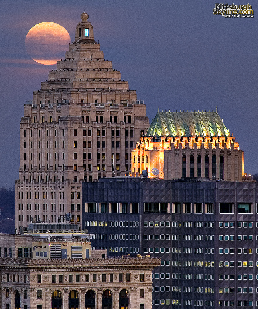 The Gulf Tower begins to eclipse the full moon