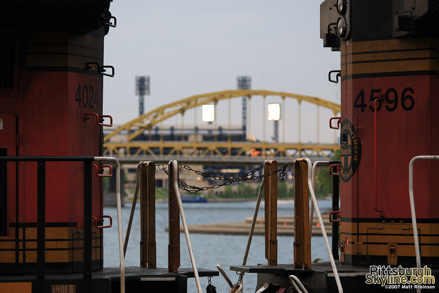 Fort Duquesne of PNC Park sandwiched between two BNSF locomotives